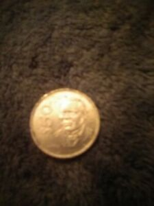 1987 $ 50.00 MEXICAN COIN IN GOOD CONDITION STAINLESS STEEL