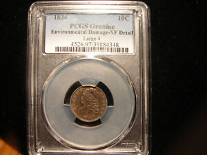 1834 CAPPED BUST 10C PCGS XF DETAIL ENVIRONMENTAL DAMAGE LARGE 4 AS PICTURED.