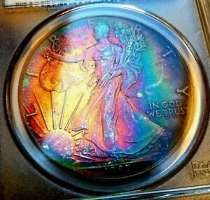 Click now to see the BUY IT NOW Price!   PCGS MS66   1987  SILVER EAGLE  AMAZING RAINBOW TONE   LIGHT MY FIRE