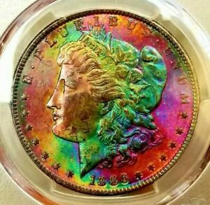 Click now to see the BUY IT NOW Price!   PCGS MS 63   CAC    1886 MORGAN DOLLAR  AMAZING RAINBOW  RUBY EMERALD