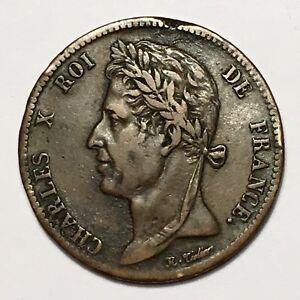 Click now to see the BUY IT NOW Price! 1825A FRENCH COLONIES 5 CENTIMES KING CHARLES X BRONZE KM 10.1  XF