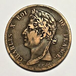 Click now to see the BUY IT NOW Price! 1827H FRENCH COLONIES 5 CENTIMES KING CHARLES X BRONZE KM 10.2 VF/XF