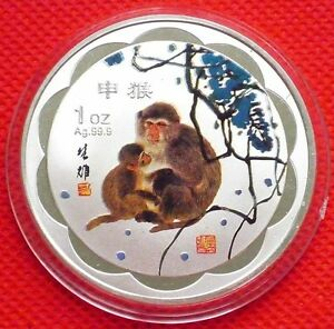 LOT OF  4  CHINESE ZODIAC  COLORIZED/SILVER LOOKING COINS   YEAR OF THE MONKEY
