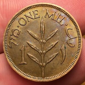 Click now to see the BUY IT NOW Price! 1935 PALESTINE 1 MIL COIN BRONZE KM 1 NICE TONING BETTER DATE UNCIRCULATED