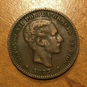 Click now to see the BUY IT NOW Price! 1877 OM SPAIN 5 CENTIMOS COIN ALFONSO XII KM 674 XF