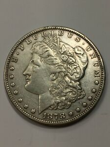Click now to see the BUY IT NOW Price! 1878 MORGAN DOLLAR 7 TAIL FEATHERS REVERSE OF 79 SILVER $1 VF