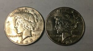 Click now to see the BUY IT NOW Price! 1928S & 1935S PEACE  SILVER DOLLAR 2 COIN LOT OF DECENT MID GRADE COINS
