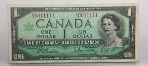 Click now to see the BUY IT NOW Price! 1967 ONE  DOLLAR BANK OF CANADA BEATTIE RASMINSKY  BINARY SN N/O 0011111NICE VF