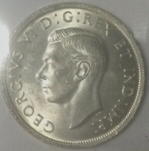 Click now to see the BUY IT NOW Price! 1939 GEORGE VI DOLLAR ICCS  MS64  XTC271 MOSTLY WHITE  SHARP COIN