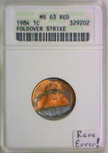 Click now to see the BUY IT NOW Price! 1984 LINCOLN CENT FOLDOVER STRIKE; ANACS MS 63 RED;  MINT ERROR