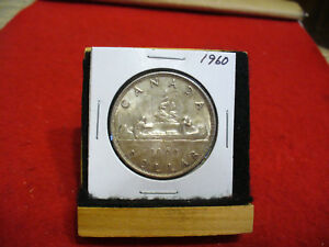 Click now to see the BUY IT NOW Price! 1960  CANADA  SILVER DOLLAR  COIN   NICE GRADE   60  SEE PHOTOS