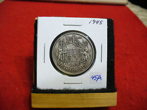 Click now to see the BUY IT NOW Price! 1945  CANADA  SILVER  HALF  DOLLAR  50 CENT PIECE   45A   GOOD GRADE