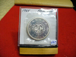 Click now to see the BUY IT NOW Price! 1964  CANADA  SILVER    DOLLAR   HIGH   GRADE    64C     PROOF LIKE    SEALED
