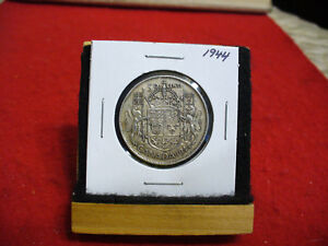 Click now to see the BUY IT NOW Price! 1944  CANADA  SILVER  HALF  DOLLAR  50 CENT PIECE   44    GOOD GRADE
