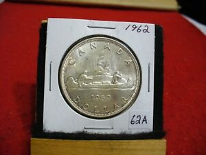 Click now to see the BUY IT NOW Price! 1962  CANADA  SILVER DOLLAR  COIN   NICE GRADE  SEE PHOTOS   62A  NICE GRADE