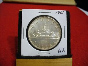 Click now to see the BUY IT NOW Price! 1961  CANADA  SILVER DOLLAR  COIN   NICE GRADE  SEE PHOTOS   61A  NICE GRADE