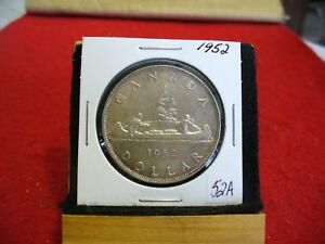 Click now to see the BUY IT NOW Price! 1952  CANADA  SILVER DOLLAR  COIN   1$   NICE GRADE  SEE PHOTOS   52A