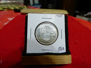 Click now to see the BUY IT NOW Price! 1958  CANADA  SILVER  HALF  DOLLAR  50 CENT PIECE   58A    NICE   GRADE