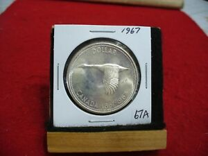 Click now to see the BUY IT NOW Price! 1967  CANADA  SILVER DOLLAR  COIN   NICE GRADE   67A  SEE PHOTOS