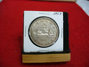 Click now to see the BUY IT NOW Price! 1957 CANADA  SILVER DOLLAR  COIN  1$  NICE GRADE  SEE PHOTOS   57