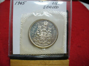 Click now to see the BUY IT NOW Price! 1965 CANADA SILVER HALF  DOLLAR TOP GRADE  50 CENT PIECE  65  PROOF LIKE  SEALED