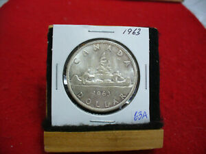 Click now to see the BUY IT NOW Price! 1963  CANADA  SILVER DOLLAR  COIN  1$  NICE GRADE   63A  SEE PHOTOS