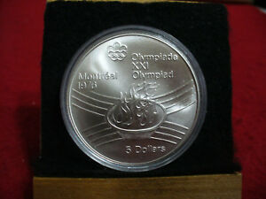 Click now to see the BUY IT NOW Price! 1976   MONTREAL  OLYMPICS   SILVER 5$ COIN   CANADA   O  FLAME   B.U.  STERLING