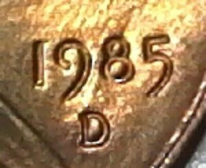 1985 D LINCOLN MEMORIAL CENT WITH ERROR ON DATE AND MINT MARK.