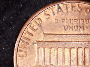 1983 LINCOLN PENNY WITH DIE CRACK ERROR ON OBVERSE.  CIRCULATED.