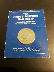 Click now to see the BUY IT NOW Price!  VINTAGE 1985 KENNEDY HALF GOLD PLATED WITH HOLDER