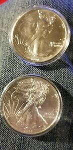 LOT OF 2 SILVER EAGLE ONE DOLLAR .999 FINE SILVER 1OZ ROUNDS   1991 & 2014