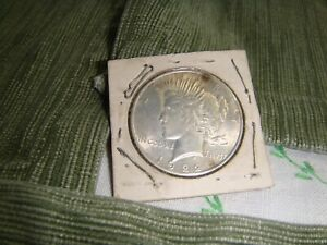 1922 PEACE SILVER DOLLAR SET IN OLD CARDBOARD GOOD LUSTER