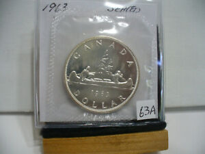 Click now to see the BUY IT NOW Price! 1963  CANADA  SILVER  1$   DOLLAR   HIGH   GRADE    63A   PROOF  LIKE    SEALED