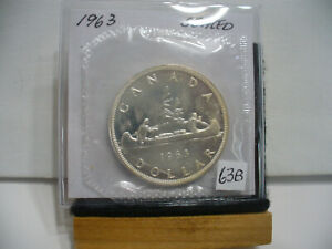 Click now to see the BUY IT NOW Price! 1963  CANADA  SILVER  1$   DOLLAR   HIGH   GRADE    63B   PROOF  LIKE    SEALED