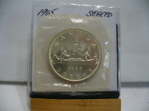 Click now to see the BUY IT NOW Price! 1965  CANADA  SILVER  1$   DOLLAR   HIGH   GRADE    65   PROOF  LIKE    SEALED