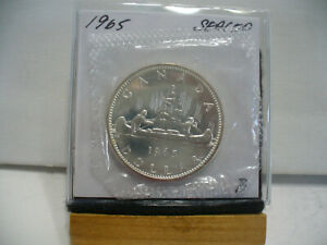 Click now to see the BUY IT NOW Price! 1965  CANADA  SILVER  1$   DOLLAR   HIGH   GRADE    65B   PROOF  LIKE    SEALED