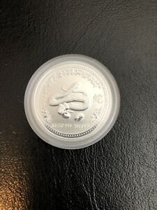 Click now to see the BUY IT NOW Price! 2001 PERTH MINT SERIES 1 LUNAR YEAR OF THE SNAKE 1/2 OZ .999 SILVER