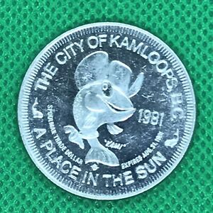 CITY OF KAMLOOPS B.C. 1981 A PLACE IN THE SUN SILVER TONE TRADE DOLLAR COIN