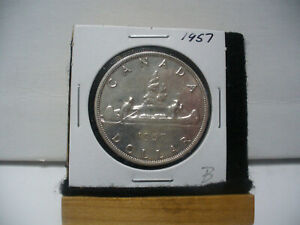 Click now to see the BUY IT NOW Price! 1957 CANADA  SILVER DOLLAR  COIN ONE  1$  NICE GRADE  SEE PHOTOS   57B