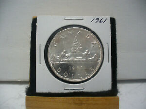 Click now to see the BUY IT NOW Price! 1961  CANADA  SILVER DOLLAR  COIN   NICE GRADE  SEE PHOTOS   61  NICE GRADE