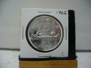 Click now to see the BUY IT NOW Price! 1962  CANADA  SILVER DOLLAR  COIN   NICE GRADE  SEE PHOTOS   62B  NICE GRADE