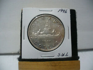 Click now to see the BUY IT NOW Price! 1946  CANADA  SILVER    DOLLAR   ONE   1 $  GOOD   GRADE    46   SEE PHOTOS