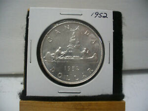 Click now to see the BUY IT NOW Price! 1952  CANADA  SILVER DOLLAR  COIN   1$   NICE GRADE  SEE PHOTOS   52