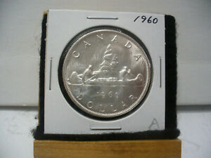 Click now to see the BUY IT NOW Price! 1960  CANADA  SILVER DOLLAR  COIN  1$  NICE GRADE  SEE PHOTOS   60A  NICE GRADE