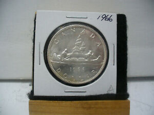 Click now to see the BUY IT NOW Price! 1966  CANADA  SILVER  ONE DOLLAR  COIN 1$   NICE GRADE    66A  SEE PHOTOS