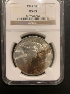 1923  P PEACE SILVER DOLLAR UNIQUE TONING NGC MS 65 GEM