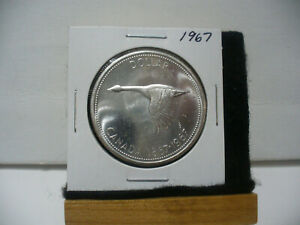 Click now to see the BUY IT NOW Price! 1967  CANADA  SILVER ONE DOLLAR  COIN ONE  1$  NICE GRADE   67  SEE PHOTOS