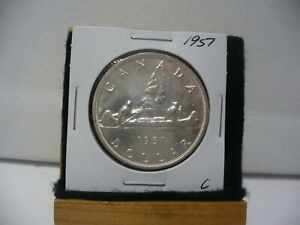 Click now to see the BUY IT NOW Price! 1957 CANADA  SILVER DOLLAR  COIN ONE  1$  NICE GRADE  SEE PHOTOS   57C