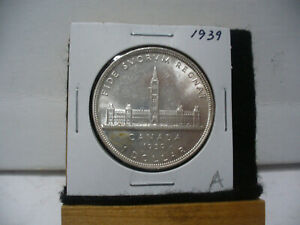 Click now to see the BUY IT NOW Price! 1939  CANADA  SILVER  1 $  ONE  DOLLAR  COIN  GOOD GRADE  SEE PHOTOS    39A