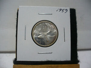 Click now to see the BUY IT NOW Price! 1959  CANADA   SILVER   QUARTER  DOLLAR  25 CENTS   NICE GRADE    59